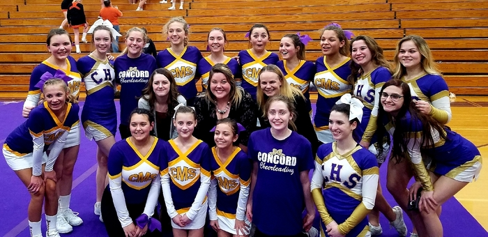 Varsity and MS cheer teams celebrate their Big 8 Conference WINS